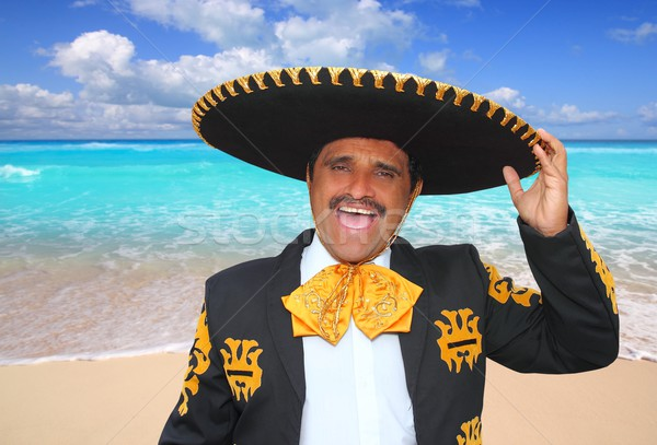 Charro mariachi singing shout in Mexico beach Stock photo © lunamarina