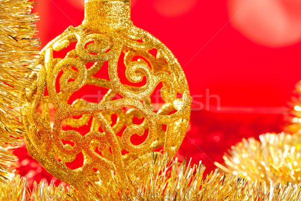Christmas card golden bauble and tinsel Stock photo © lunamarina