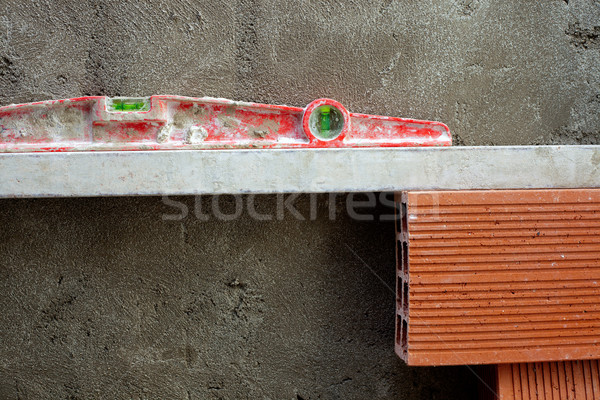 bubble spirit level tool in red on costruction cement Stock photo © lunamarina