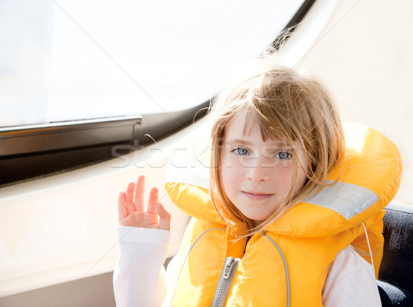 blond kid girl with marine yellow lifesaver jacket Stock photo © lunamarina