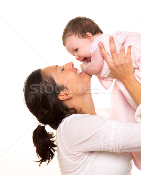 Baby girl hug in mother arms playingin happy on white Stock photo © lunamarina