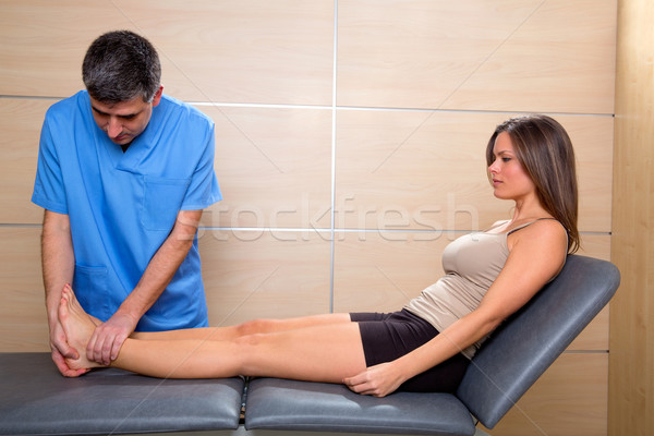 Ankle and Foot examination doctor to woman patient Stock photo © lunamarina