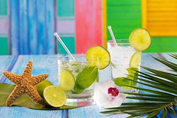 Cuban Mojito cocktail in tropical blue wood flowers and starfish Stock photo © lunamarina