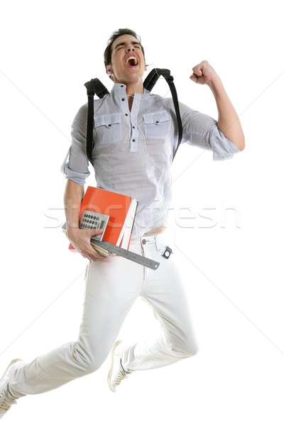 Happy student jump with college stuff in hand Stock photo © lunamarina