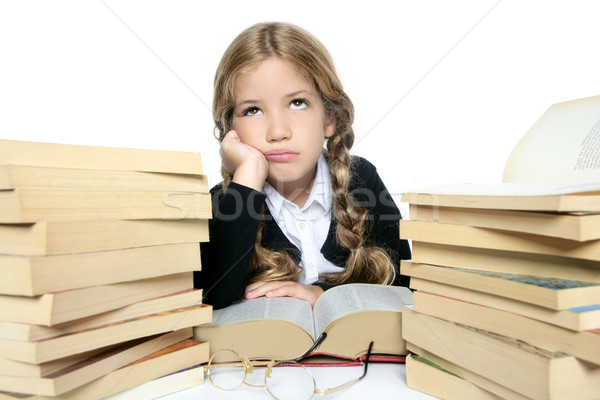 Stock photo: little unhappy sad student blond braided girl bored with stacked