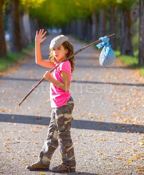 little kid with hobo stick bag and bundle girl saying goodbye Stock photo © lunamarina