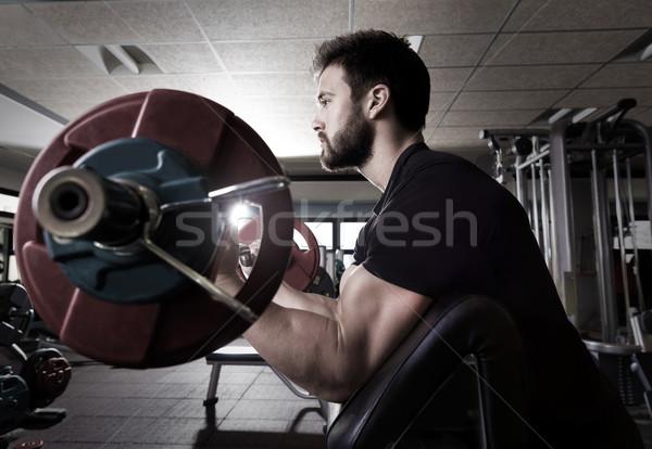 biceps preacher bench arm curl workout man at gym Stock photo © lunamarina