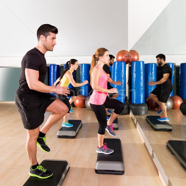 Cardio step dance group at fitness gym training Stock photo © lunamarina