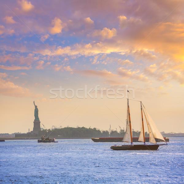 New York sailboat sunset and Statue of Liberty Stock photo © lunamarina