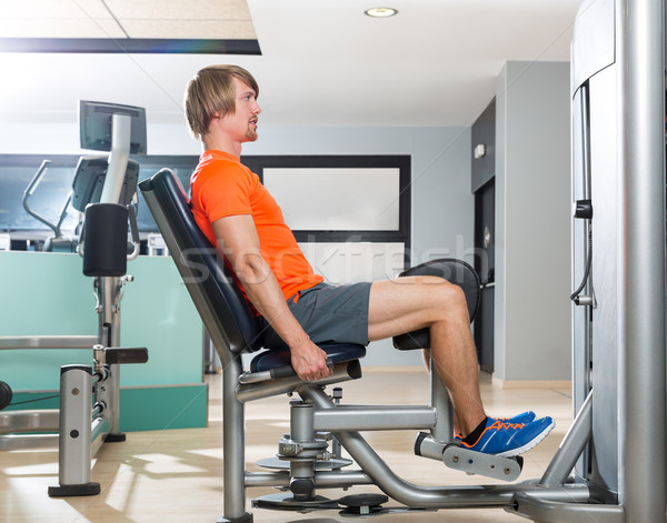 Hip abduction blond man exercise at gym closing Stock photo © lunamarina