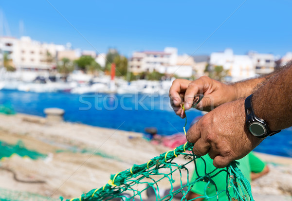 Majorca Cala Ratjada fisherman sewing fishing net Stock photo © lunamarina