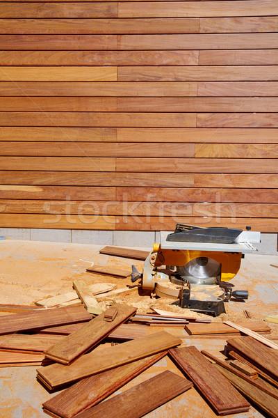 Ipe wood fence installation carpenter table saw Stock photo © lunamarina