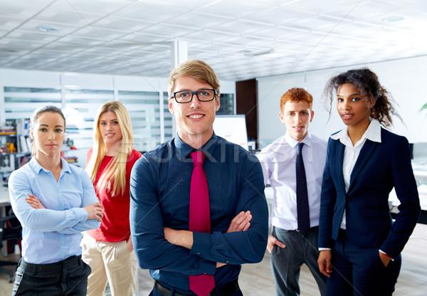 Szőke fiatal üzletember többnemzetiségű csapatmunka csoport Stock fotó © lunamarina