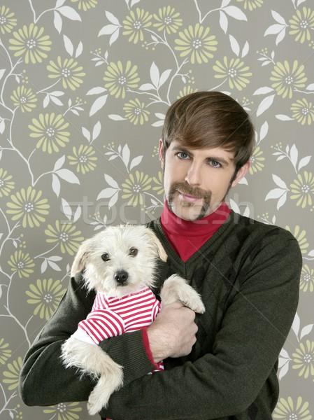 geek retro man holding dog silly on wallpaper Stock photo © lunamarina