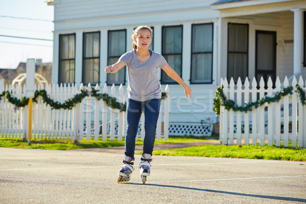 Stock photo: Teen girl rolling skate in the street