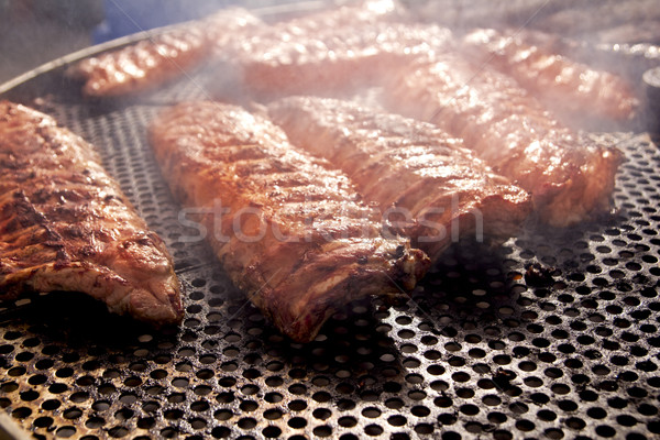 BBQ ribs grilled meat smoke fog barbecue Stock photo © lunamarina
