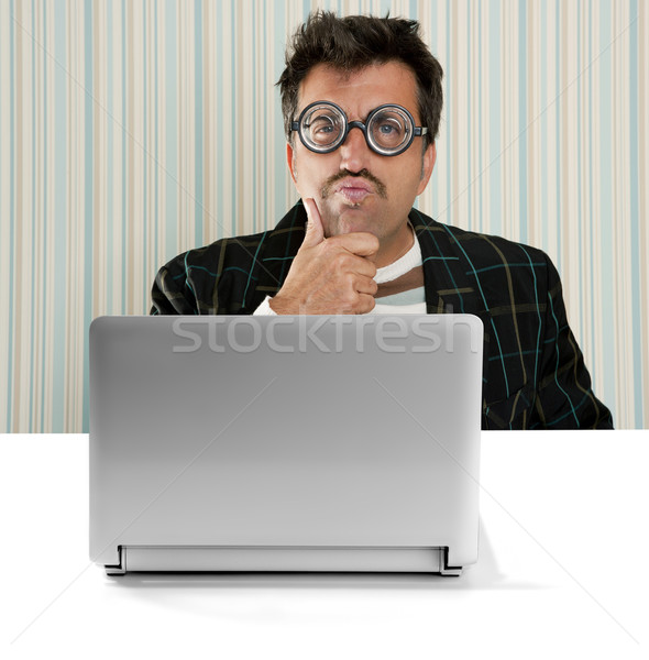 Nerd pensive man glasses silly expression laptop Stock photo © lunamarina
