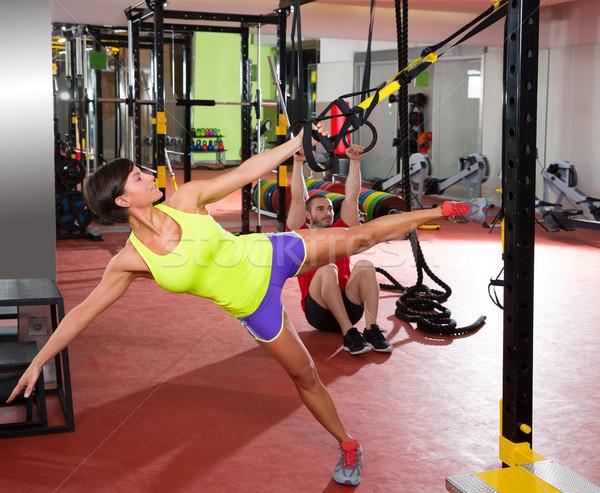 Fitness TRX training exercises at gym woman and man Stock photo © lunamarina