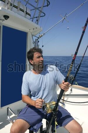 Idős halász tonhal zsákmány kezek víz Stock fotó © lunamarina