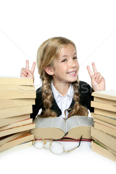 Stock photo: little student blond braided girl smiling with stacked books