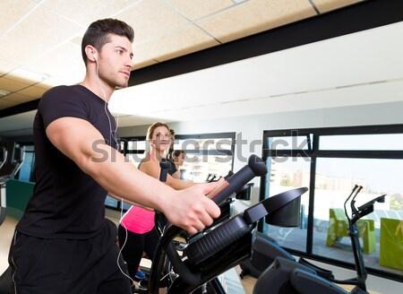 Tornaterem személyi edző férfi súlyzó nő fitnessz Stock fotó © lunamarina