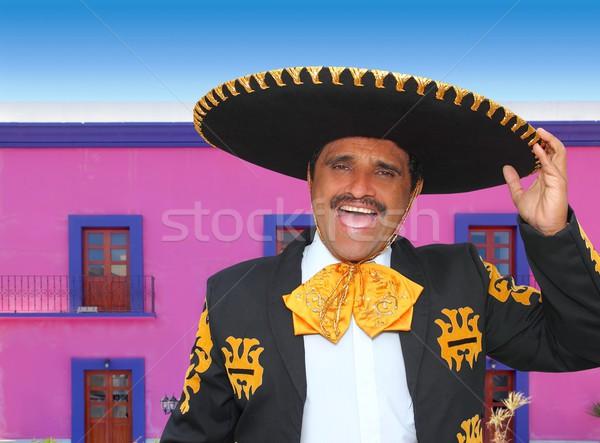Charro mariachi portrait singing in mexican house Stock photo © lunamarina