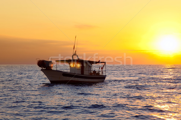 fishing boat in sunrise at Mediterranean sea Stock photo © lunamarina