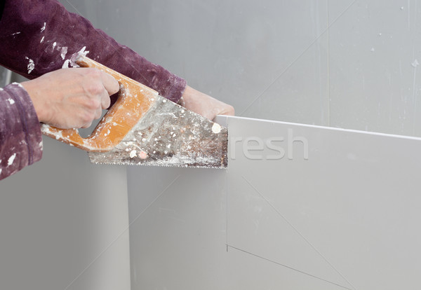 Stock photo: cutting plasterboard plaster hand dirty saw