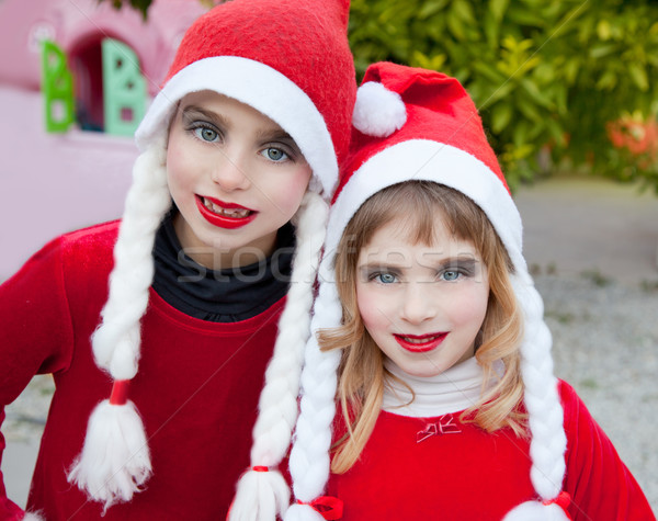 Christmas santa costumer kid girls portrait smiling Stock photo © lunamarina
