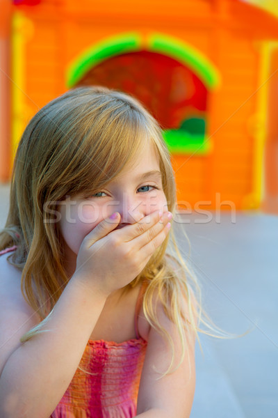 Blond kid girl funny gesture hand in mouth Stock photo © lunamarina