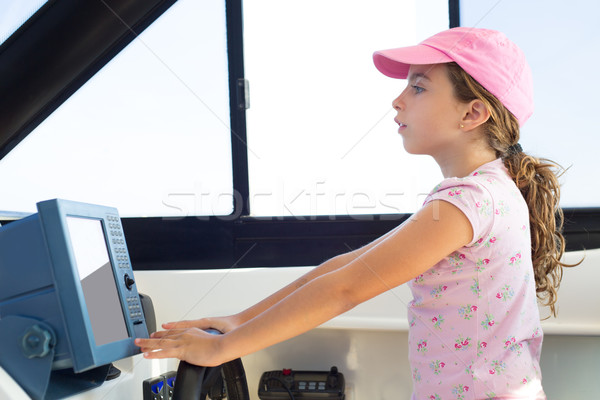 child girl sailing steering the boat wheel Stock photo © lunamarina