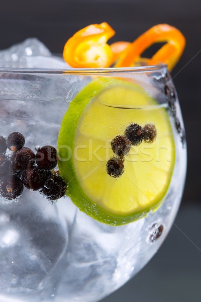 Gin tonic cocktail macro closeup with juniper berries Stock photo © lunamarina
