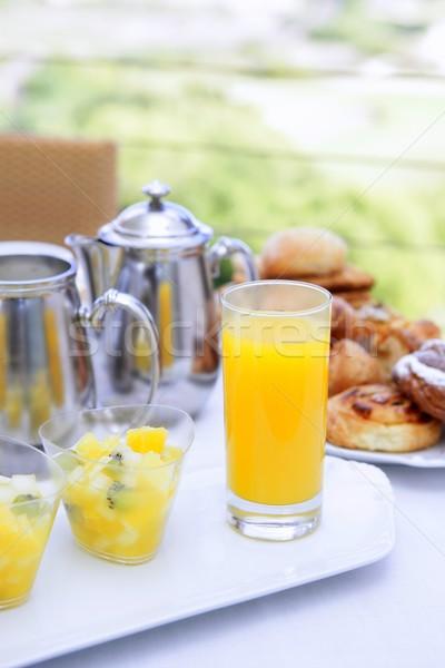 Desayuno jugo de naranja té leche panadería Foto stock © lunamarina