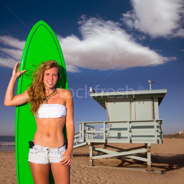 Blond surfer teen girl holding surfboard on beach Stock photo © lunamarina