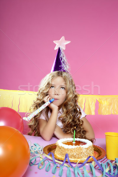 Stock photo: bored little blond girl in a birthday party with candle cake