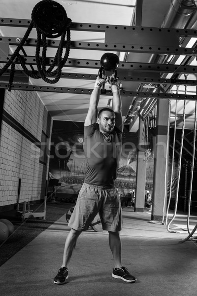 kettleblell swinging man weightlifting workout gym Stock photo © lunamarina
