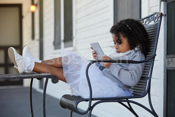 Kid девушки сидят крыльцо играет смартфон Сток-фото © lunamarina