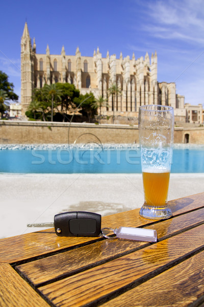 Car rental keys on wood table in Palma de Mallorca cathedral Stock photo © lunamarina