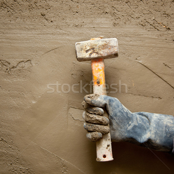 hammer man with gloves in grunge cement background Stock photo © lunamarina