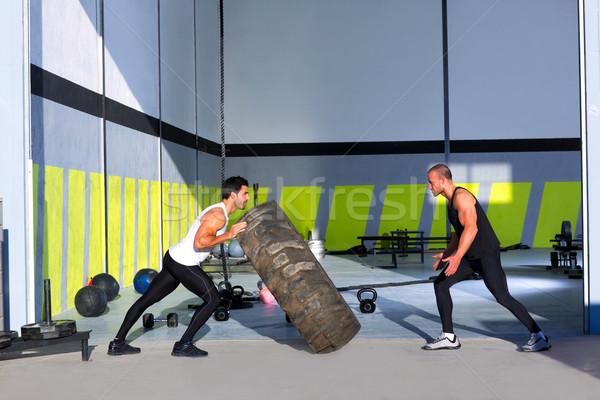 Crossfit flip tires men flipping each other Stock photo © lunamarina