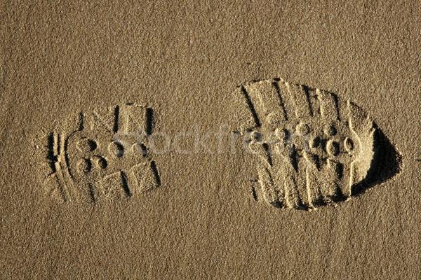 boot shoe footprint over beach sand Stock photo © lunamarina
