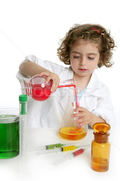 Girl pretending to be doctor in laboratory Stock photo © lunamarina