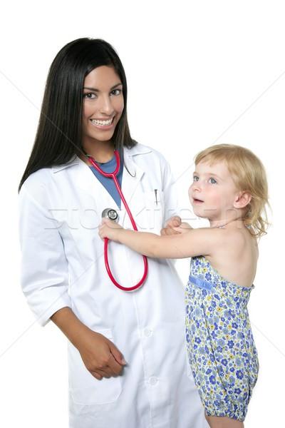 Brunette pediatric doctor with blond little girl Stock photo © lunamarina