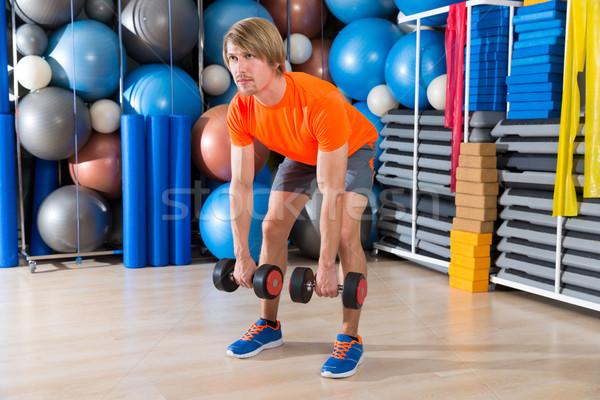 dumbbell deadlift blond man at gym weightlifting Stock photo © lunamarina