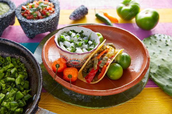 Taco mexicaans eten ingrediënten kleurrijk tabel Stockfoto © lunamarina