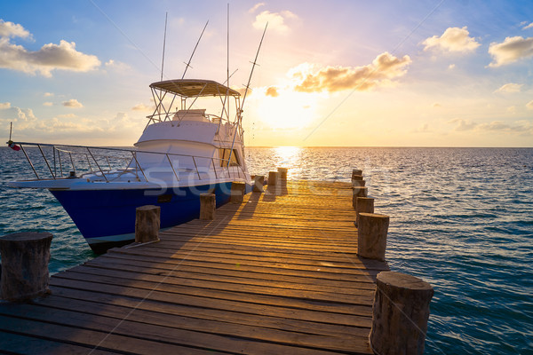 Riviera Maya sunrise boat at beach pier Stock photo © lunamarina