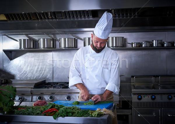 Chef cutting chives in restaurant kitchen Stock photo © lunamarina