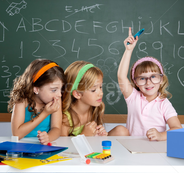 boring  student with clever children girl raising hand Stock photo © lunamarina