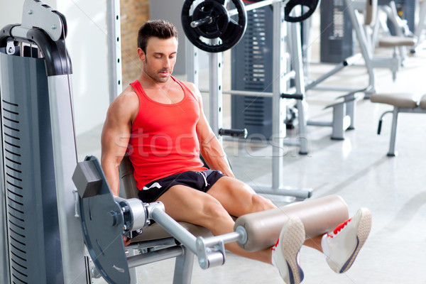 man lifting weights with a leg press on sport gym Stock photo © lunamarina