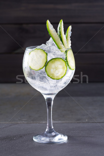 Gin tonic cocktail with cucumber and ice on black Stock photo © lunamarina